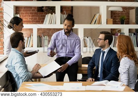 African Ethnicity Team Leader Led Group Briefing In Modern Office