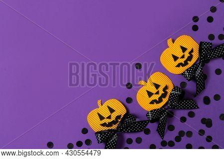 Kids Halloween Handmade Paper Pumpkins, Creative, Craft Concept On Purple Background, Top View, Copy