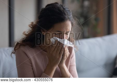 Sick Young Woman Sitting Indoors Holding Tissue Blowing Running Nose