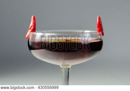 Cocktail Drink Prepared With Vodka, Grenadine And Lemon Juice Decorated With Bird Eye Chillies In Th