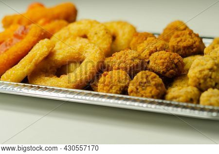 Southern Fried And Roast Chicken Bites, Onion Rings And Mozzarella Stick Served On The Silver Tray,