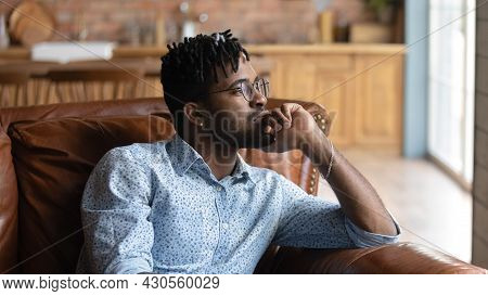 Thoughtful Bored Millennial Black Mixed Race Guy Lost In Thoughts