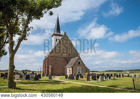 Texel, The Netherlands. August 2021. The Old Church With Cemetery In Den Hoorn At Texel, Holland.