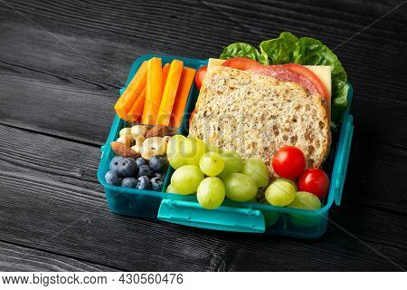 Healthy School, Work Lunch Box With Sandwiches And Fresh Vegetables, Nuts And Fruits On Wooden Table