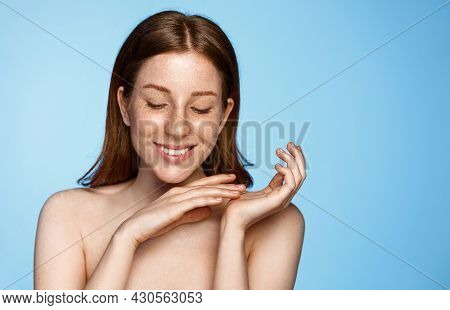 Skin Care And Facial Treatment. Young Woman With Clean And Glowing Body And Face, Smiles, Gently Tou