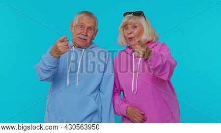 Lovely Senior Couple Man Woman Grandparents Pointing Finger To Camera, Laughing Out Loud, Taunting M