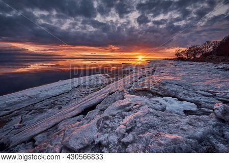 Dramatic Winter Sunset And Icy Chaos On The Baltic Sea Before The Onset Of Spring.