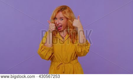 Long Haired Lovely Girl In Yellow Dress Raises Thumbs Up Agrees With Something Or Gives Positive Rep