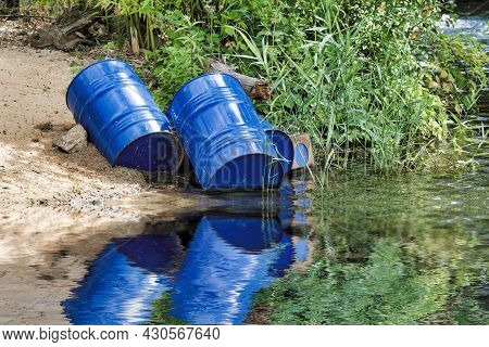 Dumped Blue Oil Drums Cause Pollution In The Water, More And More The Water Is Polluted By Throwing