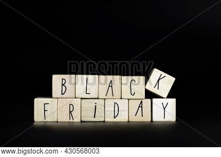 Black Friday Text Written With Wooden Cubes On Black Background Horizontal, Simplicity Modern Backgr