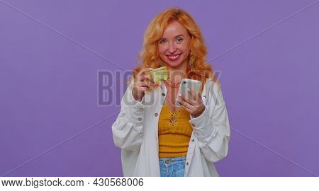 Happy Redhead Pretty Girl 20s Years Old In White Shirt Using Credit Bank Card And Smartphone While T