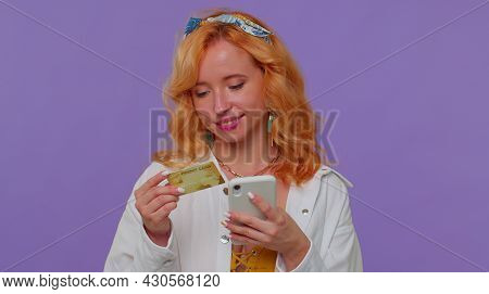 Sincere Redhead Lovely Girl 20s Years Old In White Shirt Using Credit Bank Card And Smartphone While