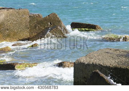 Sea View. Panorama Of The Sea And Sky. Concrete Sea Fortification. Breakwaters