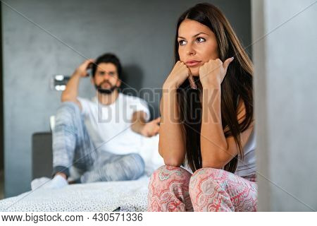 Couple Having Arguments And Sexual Problems In Bed
