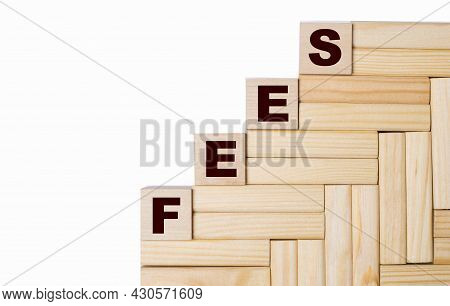 On A Light Background, Wooden Blocks And Cubes With The Text Fees