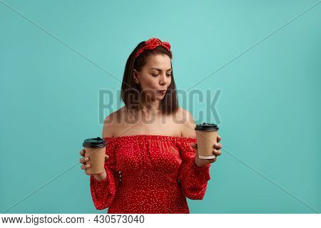 Caucasian Brunette In Red Dress With Bare Shoulders Wearing Hair Band Holds Two Paper Takeaway Cups