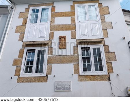 Mondonedo, Spain - August 08, 2021: Marble Plaque And Portrait Marking A Home Of Writer,journalist A