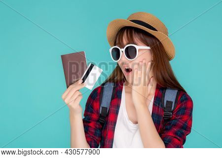 Beautiful Young Asian Woman Excited And Surprise With Showing Credit Card And Passport To Travel Sum