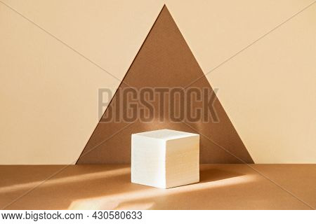 Square Wooden 3d Podium For Displaying Goods On Abstract Brown-beige Background In Form Of A Triangl