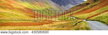 Honister Pass, A Mountain Pass With A Narrow Road Winding Along Gatesgarthdale Beck Mountain Stream.
