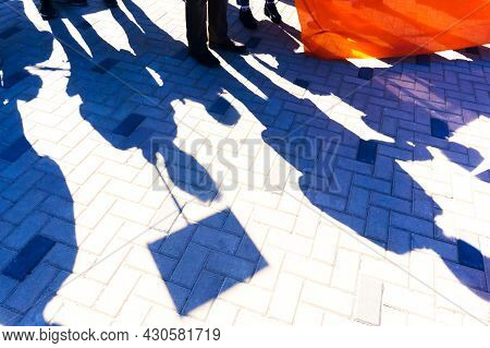 A Strike In The Streets Of The City. Shadows Of People Protesting Against Modern Power