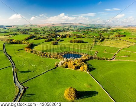 Aerial View Of Endless Lush Pastures And Farmlands Of England. Beautiful English Countryside With Em