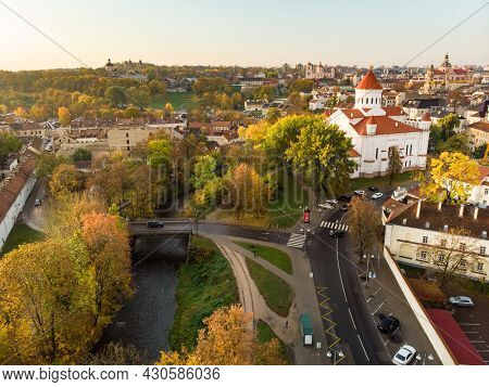Beautiful Vilnius City Panorama In Autumn With Orange And Yellow Foliage. Aerial Evening View. Fall