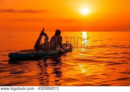 June 21, 2021. Anapa, Russia. Sporty Girl On Stand Up Paddle Board At Quiet Sea With Sunset Or Sunri