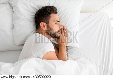 Asleep Millennial Man Sleeping, Resting Peacefully In Comfortable Bed, Lying With Closed Eyes, Top V