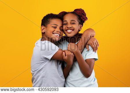 Loving Black Boy Hugging His Pretty Sister