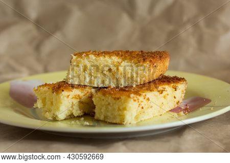 Pieces Of Baked Mannik Semolina Casserole On Yellow Plate