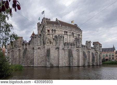 Gent, Flanders, Belgium - July 30, 2021: Gray Stone Gravensteen Medieval Castle Under Gray Cloudscap