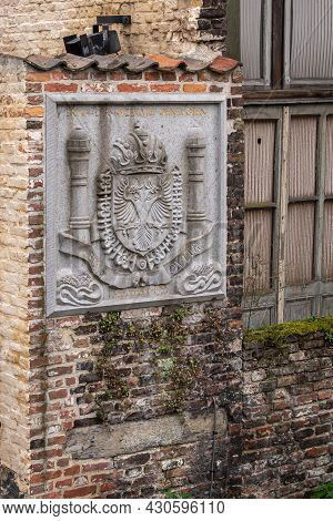 Gent, Flanders, Belgium - July 30, 2021: Closeup Of Gray Stone Emperor Charles V Coat Of Arms Set In