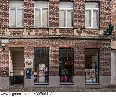 Gent, Flanders, Belgium - July 30, 2021: Facade Of Ovaert Pharmacy In Geldmunt Street Consists Of Th