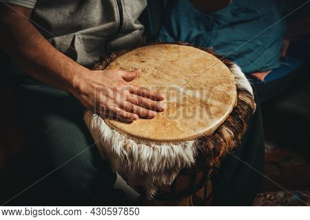 The Drummer Plays The Ethnic Percussion Musical Instrument Djembe.