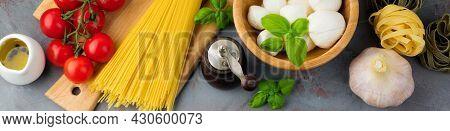 Raw Ingredients For The Preparation Of Italian Pasta, Spaghetti, Tagliatelle, Fusilli, Garlic, Basil