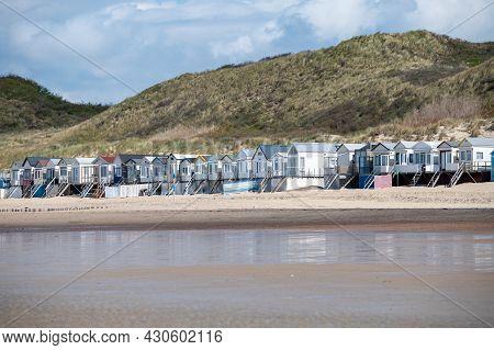Small Beach Huts On White Sandy North Sea Beach Near Zoutelande, Zeeland, Netherlands