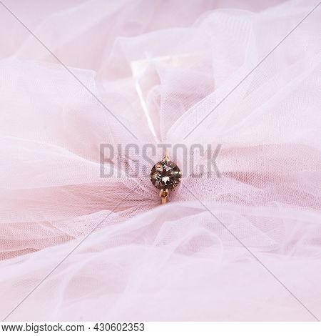 Jewelry In Pink Fabric. Wedding Ring For A Marriage Proposal.