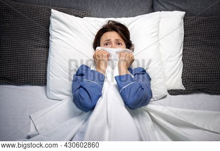 Worried Woman With Nightmares Lying In Bed And Covering Face With Blanket. Middle Aged Brunette Unab