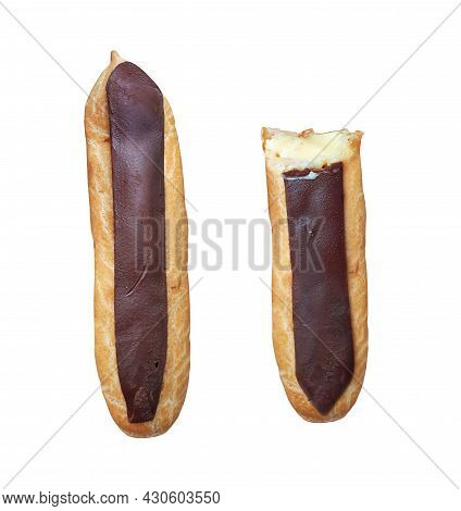 There Are Two Chocolate Eclairs. White Background. Isolated.