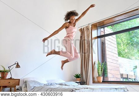 Good Morning Concept. Happy Carefree Positive Playful Young African American Woman Wearing Pajamas J