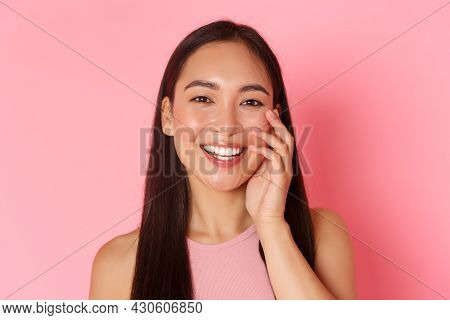 Beauty, Fashion And Lifestyle Concept. Close-up Of Beautiful Asian Young Girl Without Acne Or Blemis