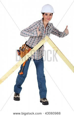 Female carpenter giving the thumbs-up