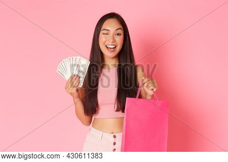 Beauty, Fashion And Lifestyle Concept. Portrait Of Sassy Good-looking Asian Girl Shopaholic Winking,