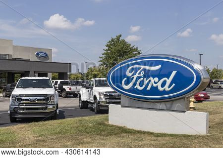 Indianapolis - Circa August 2021: Ford F-series Truck Display At A Dealership. Ford Sells Traditiona