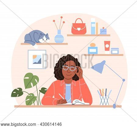 Attractive Black Woman Writes Diary Concept. Young Flat Sitting Afro Girl Portrait With Pen In Hand