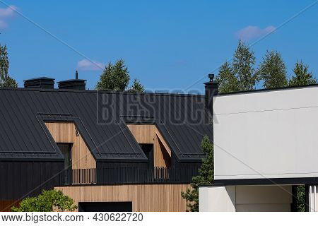 A Modern Family Home With A Trendy Design. Gray Roof, Sand Walls.
