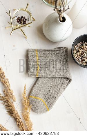 Gray Woolen Knitted Socks On White Wooden Table