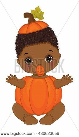 Cute Little African American Baby Boy Is Curly Wearing Pumpkin Outfit. Little Pumpkin Is Cute. Pumpk