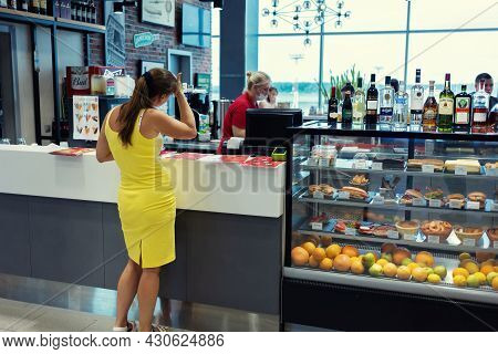Moscow, Russia, Airport Domodedovo - July 19, 2021: Woman Waiting An Order In A Coffee Shop Bar